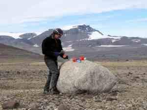 Sampling a granite erratic boulder for cosmogenic nuclide dating, NE Antarctic Peninsula, 2011. Photo credit: Bethan Davies