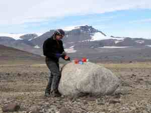 Sampling a granite erratic boulder for cosmogenic nuclide dating, NE Antarctic Peninsula, 2011. Photo credit: Bethan Davies