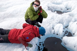 Dr Arwyn Edwards (front) and I examining large cryoconite pools near the margin on the Greenland ice sheet (ph. Sara Penrhyn-Jones)