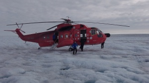 Dr Irvine-Fynn: out of the helicopter and onto the ice...