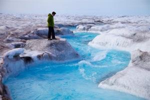 Greenland ice sheet melt in action: observing surface runoff in a stunning supraglacial stream (ph. Sara Penrhyn-Jones)